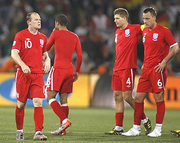 England  players wear a dejected look after being knocked-out by Germany
