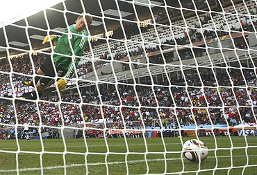 Germany 'keeper Manuel Neuer watches as a Frank Lampard shot crosses the line