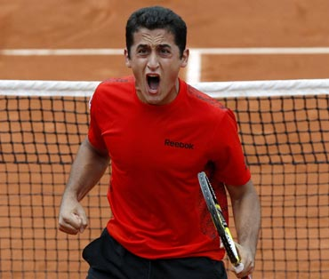 Nicolas Almagro celebrates after beating Fernando Verdasco