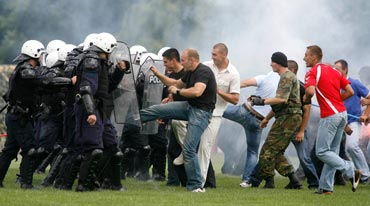 Hooligans clash with police during a match