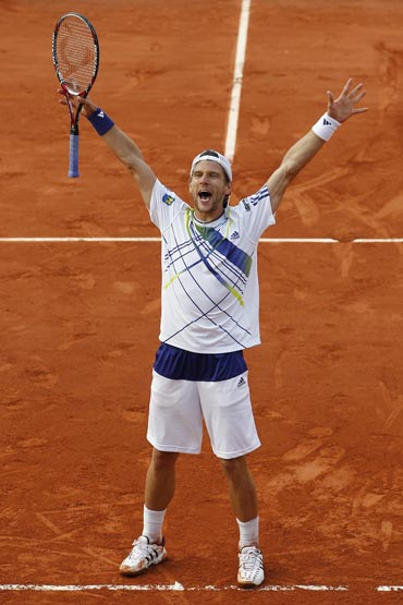 Jurgen Melzer celebrates after beating Novak Djokovic