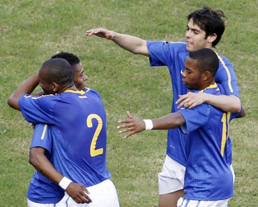 Brazilian players celebrate after scoring against Zimbabwe during a friendly match