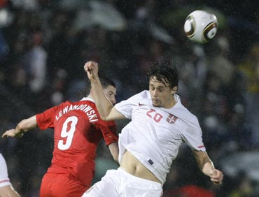 Serbia's Subotic fights for the ball with Poland's Lewandowski during a friendly match in Kufstein