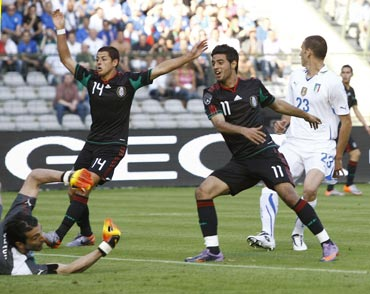 Mexico's Carlos Vela celebrates after scoing against Italy during their warm-up matches