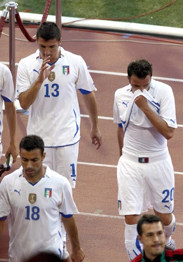 Italy playes walk off the pitch after their friendly match against Mexico