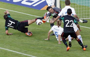 Mexico's Hernandez challenges Italy's goalie Buffon during their international friendly match