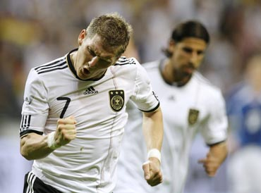 Bastian Schweinsteiger celebrates after scoring against Bosnia
