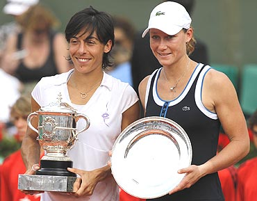 Francesca Schiavone (left) and Samantha Stosur with their trophies after the presentation ceremony