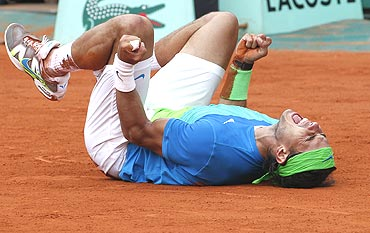 Rafael Nadal celebrates after winning the French Open