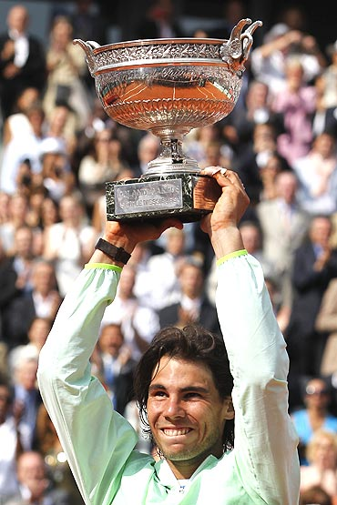 Rafael Nadal holds aloft his trophy after winning the French Open final on Sunday