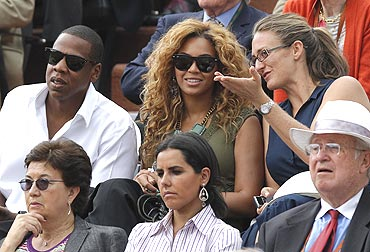 Former French Open champion Mary Pierce (right) chats with American musicians Beyonce (centre) and Jay-Z during the French Open men's final