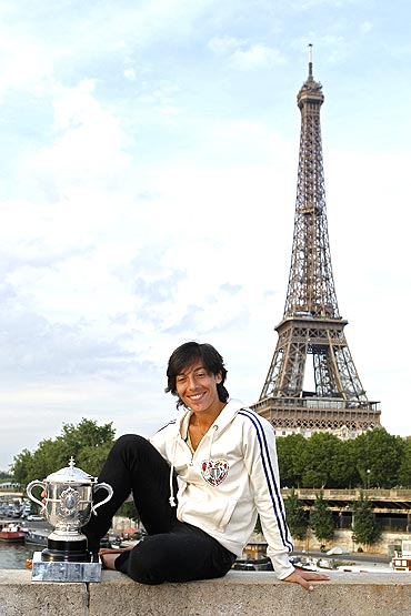 Francesca Schiavone of Italy poses with her trophy near the Eiffel Tower