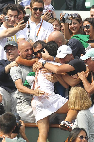 Francesca Schiavone of Italy is congratulated by supporters