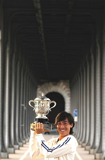 Francesca Schiavone poses with her trophy on the Bir-Hakeim bridge in Paris