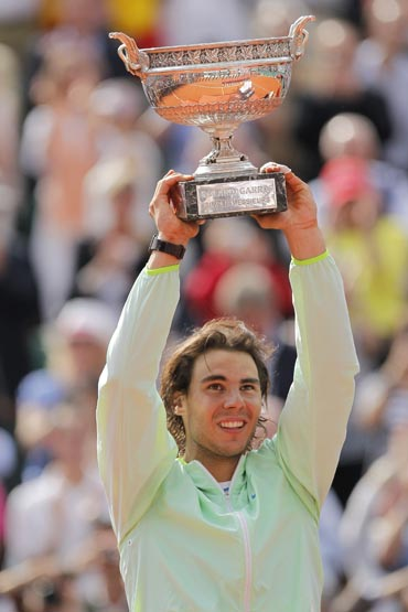 Rafael Nadal lifts the French Open trophy after beating Robin Soderling