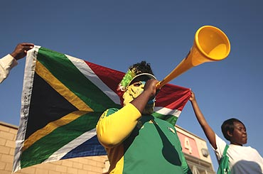 A supporter of South Africa blows his vuvuzela