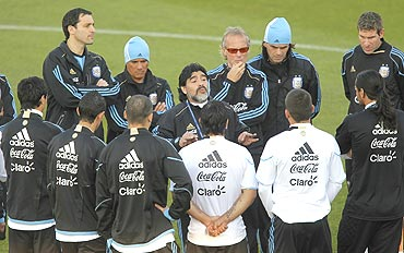 Argentina's coach Diego Maradona speaks with players during a training session in Pretoria