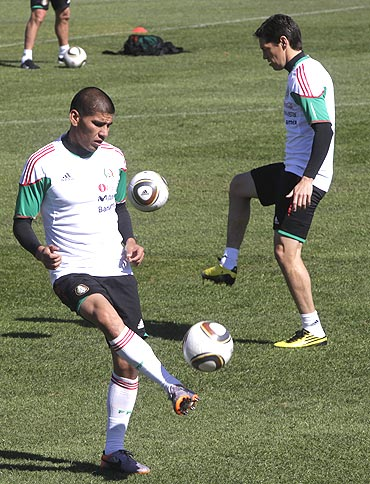 Mexico's Ricardo Osorio (left) and Guillermo Franco go through the gring during a practice session
