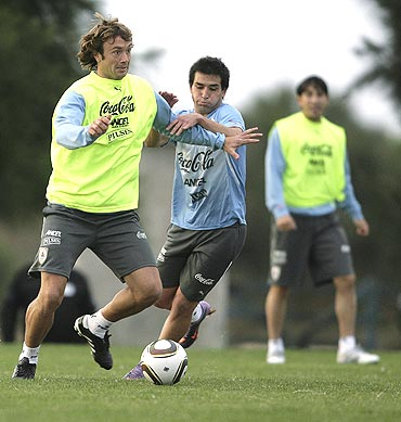 Uruguay's Diego Lugano (left) and Nicolas Lodeiro vie for possession during a practice match
