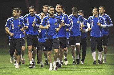 The Greek football team go through the motions during a training session