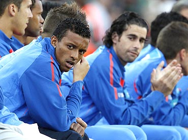 Portugal's Nani (left) watches the match from the bench