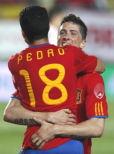Spain's Fernando Torres (right) celebrates with team-mate Pedro Rodriguez after netting the fifth goal