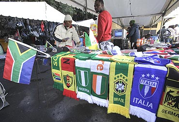 Street vendors sell football world cup memorabilia in Cape Town