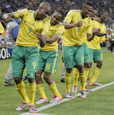 -South Africa's Siphiwe Tshabalala dances with team mates