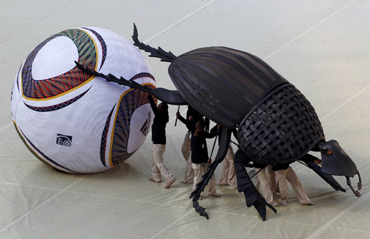 Performers carry replica of dung beetle during opening ceremony of the 2010 World Cup at Soccer City stadium