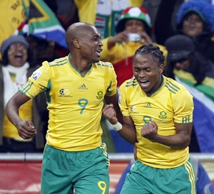 Tshabalala celebrates his goal against Mexico with team mate Mphela