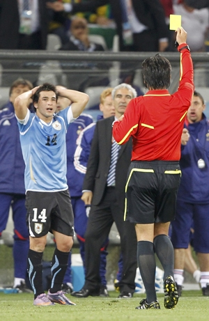 Lodeiro reacts as referee Nishimura shows him his second yellow card