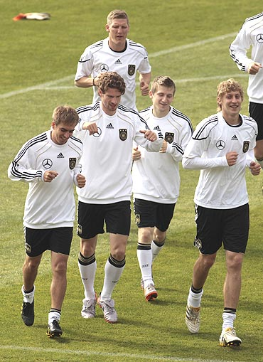 Germany's players warm up during a training session in Pretoria