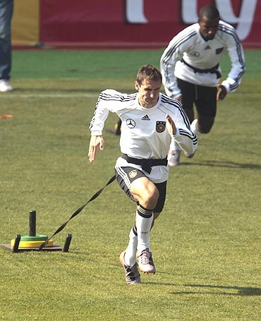 Germany's Miroslav Klose and Cacau (right) go through the grind during a training session in Pretoria