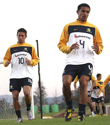 Australia's Harry Kewell (left) and Tim Cahill jog during a practice session