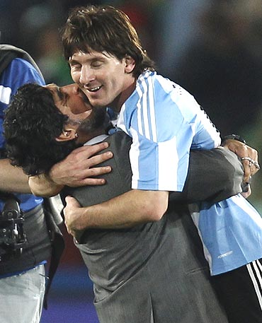 Argentina's coach Diego Maradona (left) hugs Lionel Messi after the match