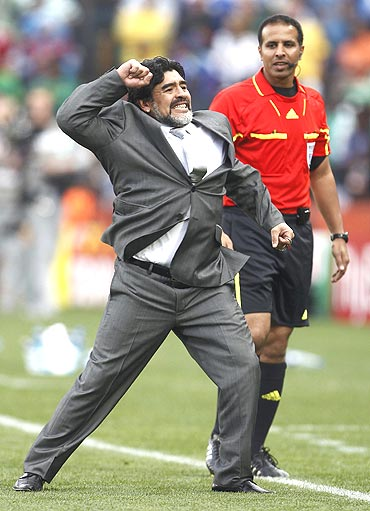 Argentina's coach Diego Maradona celebrates after Heinze's goal