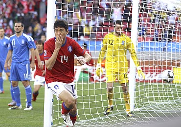 Lee Jung-soo celebrates afterscoring the first goal