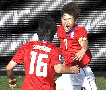 Parki Ji-sung celebrates after scoring with team-mates