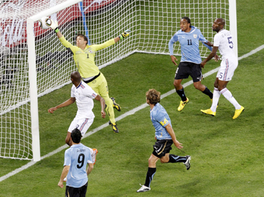 Uruguay's goalkeeper Muslera clears the ball during the 2010 World Cup Group A soccer match against France