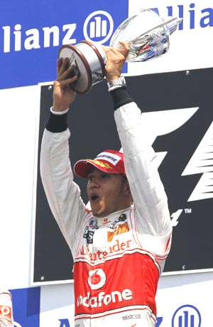 Lewis Hamilton rejoices after winning the Canadian GP