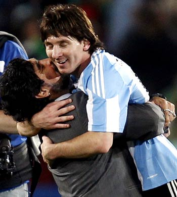 Argentina's coach Diego Maradona ccelebrates his team's win over Nigeria with Lionel Messi