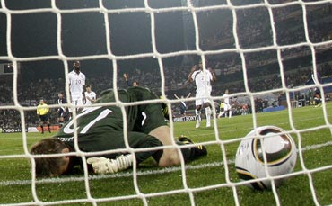 Robert Green reacts after missing the ball