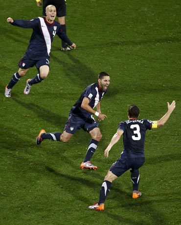 Clint Dempsey celebrates after scoring the equaliser