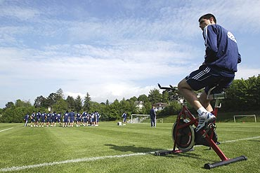 Paraguay's Oscar Cardozo (left) cycles as his team-mates train during a practice session