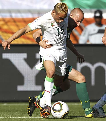 Algeria's Karim Ziani (left) fights for the ball against Slovenia's Miso Brecko