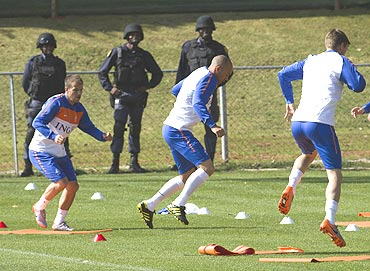 The Netherlands's Rafael van der Vaart (left), Demy de Zeeuw (centre) and Klaas Jan Huntelaar (right) at a training camp