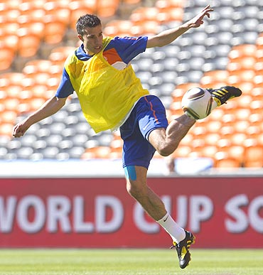 Robin van Persie of the Netherlands kicks the ball during a training session