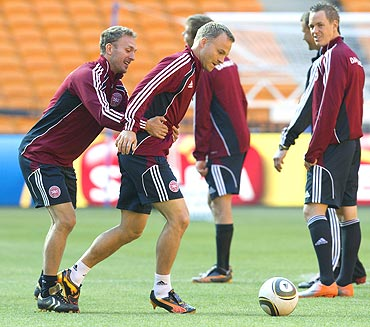 Denmark's Dennis Rommedahl (left) and team-mate Lars Jacobsen share a light moment during a training session