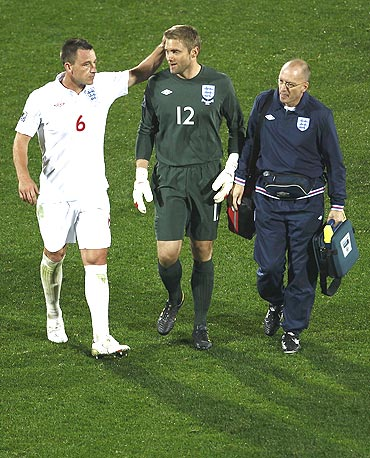 england's john terry consoles robert green (centre) after the match