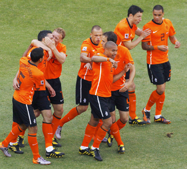 Netherlands' players celebrate after an own goal by Denmark